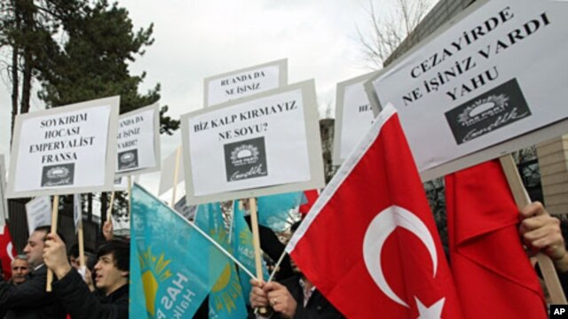 Members of a pro-Islamic party shout slogans against France and French President Nicolas Sarkozy outside the French Embassy in Ankara, Turkey, December 21, 2011