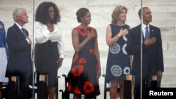"Former U.S. president Bill Clinton (L-R), Oprah Winfrey, U.S. first lady Michelle Obama, Caroline Kennedy, and U.S. President Barack Obama are pictured during the national anthem at a ceremony marking the 50th anniversary of Martin Luther King's ""I have a"