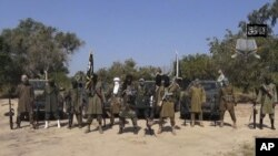 FILE - In this file image taken from video released Oct. 31, 2014, by Boko Haram, shows Abubakar Shekau, center, the then-leader of Nigeria's Islamic extremist group.