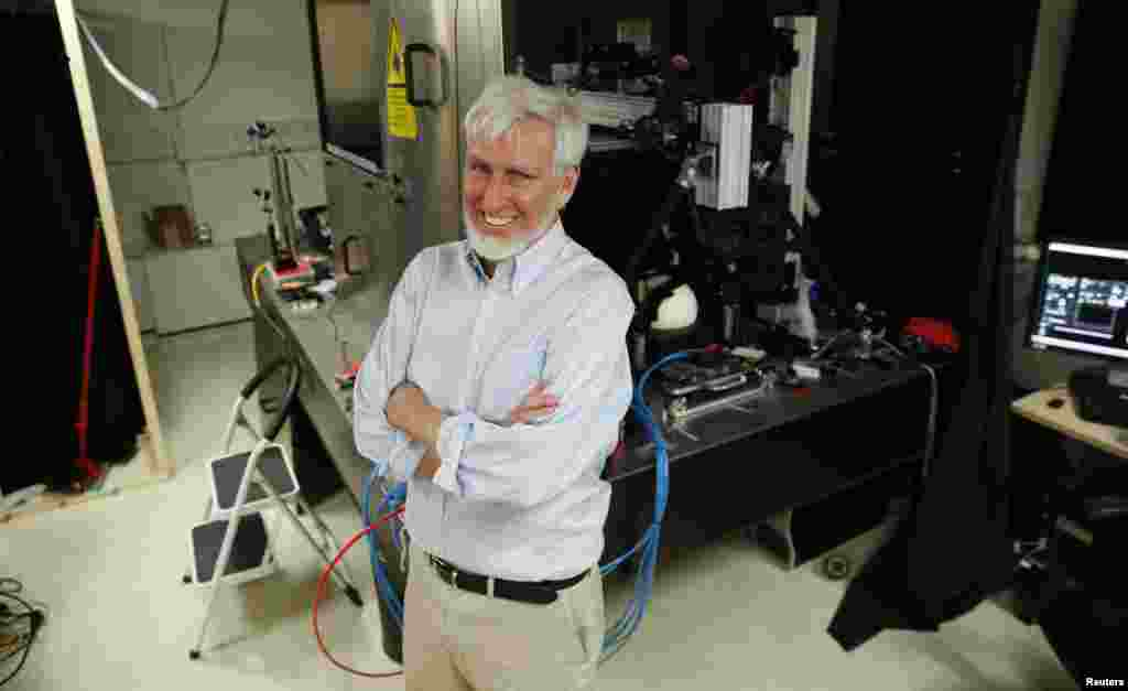 Professor John O'Keefe, one of three winers of the 2014 Nobel Prize for medicine, poses in his laboratory at University College London, in London, England, Oct. 6, 2014.