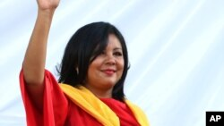 FILE - Gisela Mota waves during her swearing in ceremony as mayor of Temixco, Morelos State, Mexico, Jan. 1, 2016.
