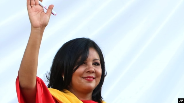 Gisela Mota waves during her swearing in ceremony as mayor of Temixco, Morelos State, Mexico, Jan. 1, 2016.
