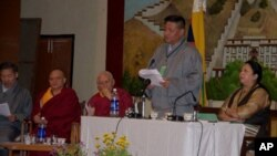 Mr Penpa Tsering (2nd right) delivers the opening statement of the Second Tibetan National General Meeting on the devolution of His Holiness the Dalai Lama's administrative and political powers to the elected Tibetan leadership.