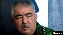 FILE - Abdul Rashid Dostum, who now is Afghanistan's first vice president, speaks during an interview with Reuters in Shibergan, in northern Afghanistan, Aug. 19, 2009.