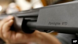 The Remington name is seen etched on a model 870 shotgun at Duke's Sport Shop in New Castle, Pa, March 1, 2018.