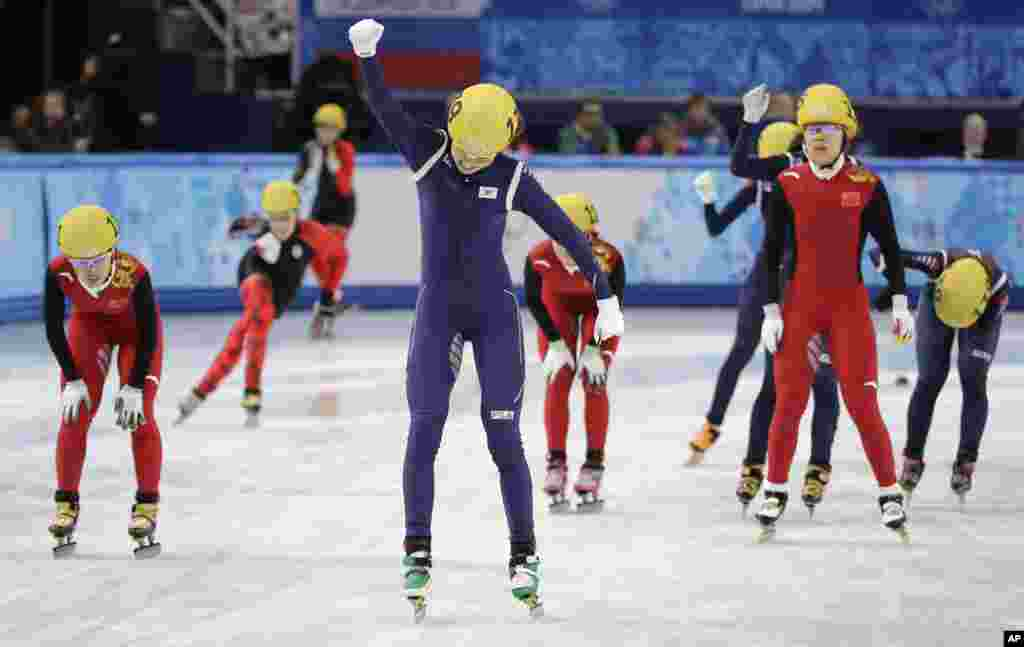Shim Suk-Hee of South Korea celebrates her team's first place in the women's 3000m short track speedskating relay final at the Iceberg Skating Palace during the 2014 Winter Olympics, Feb. 18, 2014.