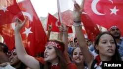 FILE - Demonstrators wave Turkish flags as they shout nationalist slogans during a protest against Kurdistan Workers' Party (PKK) in central Istanbul, Aug. 16, 2015.