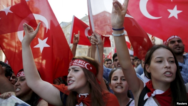 Demonstrators wave Turkish flags as they shout nationalist slogans during a protest against Kurdistan Workers' Party (PKK) in central Istanbul, August 16, 2015.