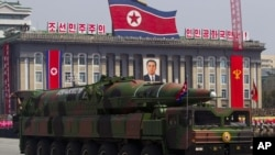 A North Korean vehicle carrying a missile is seen by during a military parade in Pyongyang, April 15, 2012.