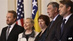 US Secretary of State Hillary Rodham Clinton, second left, High Representative for EU Foreign Policy Catherine Ashton, center, Bakir Izetbegovic Chairman of the Bosnia and Herzegovina Tri-Presidency, left, and members of the Bosnia Tri Presidency, Neboj Radmanovic, second right, and Zeljko Komsic, right, pose for a photo prior to meetings at the Presidency in Sarajevo, Bosnia.