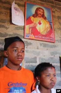 Lerato Tsamai (right), with her younger brother in their home in Freedom Square, Mangaung. She, too, couldn't acess ARVs, but her life was saved when an NGO gave her the medicine
