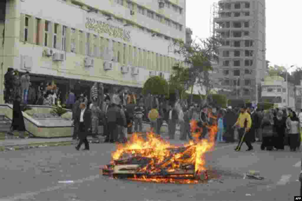 Egyptian protesters, who claim delays for their requests for housing, start a fire in front of local government headquarters Port Said Egypt, Thursday, Feb. 10, 2011. Labor unrest across the country gave powerful momentum to Egypt's wave of anti-governm