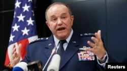 "FILE - U.S. Air Force General Philip Breedlove, pictured at a Kyiv news conference in November 2014, says Russia is seeking to tighten its grip on separatist fighters ""because there was disunity"" inn some earlier attacks."