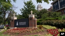 FILE - In this July 6, 2021, file photo, an electronic signboard welcomes people to the Howard University campus in Washington. Howard is one of more than 100 HBCUs recognized by the U.S. Department of Education. (AP Photo/Jacquelyn Martin, File)