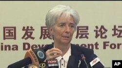 Christine Lagarde ຫົວໜ້າອົງການ IMF ໃນກອງປະຊຸມ ທີ່ປະເທດຈີນ, ວັນທີ 18 ມີນາ 2012.