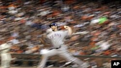 Texas Rangers' Cliff Lee throws during the second inning of Game 1 of baseball's 2010 World Series against the San Francisco Giants.