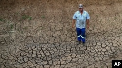 Riaan du Plessis, a farmer, stands on the cracked earth on his farm in Groot Marico, South Africa. (File)