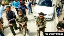 یکی ازعکس های منتشر شده توسط شبکه جام جم از نیروهای ایرانی در خان طومان