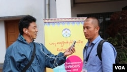 FILE - Gyaltsen Choedak, VOA Tibetan Service, is seen working at a conference in 2018. Many journalists reporting on events inside Tibet rely on messaging apps and sources who risk prison and retaliation against their families for speaking out.