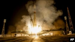 The Soyuz-FG booster rocket with the space capsule Soyuz TMA-14M is launched to the International Space Station from the Russian leased Baikonur cosmodrome, Kazakhstan, in Kazakhstan, early Thursday, July 23, 2015.