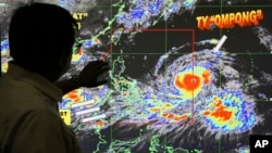 "Forecaster Meno Mendoza shows the path of Super Typhoon Mangkhut, locally named ""Typhoon Ompong,"" as it approaches the Philippines at the Philippine Atmospheric, Geophysical and Astronomical Services Administration in Manila, Sept. 12, 2018."