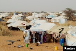 FILE - Tents set up by the United Nations High Commissioner for Refugees (UNHCR) are seen in a refugee camp for Malians in Mbera, Mauritania, about 40 km (25 miles) from the border with Mali, May 23, 2012.