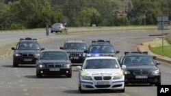 A security convoy leaves 1 Military Hospital, shortly before it was announced that former President Nelson Mandela had been discharged from an undisclosed hospital, in Pretoria, February 26, 2012.