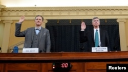 George Kent, a deputy assistant secretary of state and Ambassador Bill Taylor sworn in Nov. 13, 2019 at a House Intelligence Committee hearing as part of the impeachment inquiry.