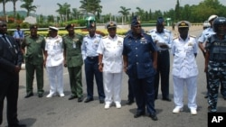 FILE - Members of Nigeria's military leadership are seen in a May 26, 2014, photo in Abuja, Nigeria.