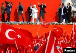 Turkish President Tayyip Erdogan and his wife Emine Gulbaran attend Democracy and Martyrs Rally, organized by him and supported by ruling AK Party (AKP), oppositions Republican People's Party (CHP) and Nationalist Movement Party (MHP), to protest against