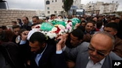 FILE - Palestinians chant slogans as they carry the body of Abdel-Fattah al-Sharif, during his funeral, in the West Bank city of Hebron, May 28, 2016. On Wednesday, an Israeli military court convicted a young soldier, Sgt. Elor Azaria, of manslaughter in the killing of al-Sharif.