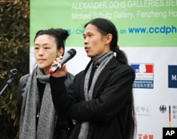 Photographer and gallery owner Rong Rong speaks at opening of Caochangdi PhotoSpring