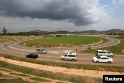 Vehicles drive on the interchange of the new Chinese-built 51-kilometer (31-mile) four-lane expressway connecting Uganda's capital Kampala to Entebbe International Airport, in Kampala, Uganda, Jan. 29, 2018.