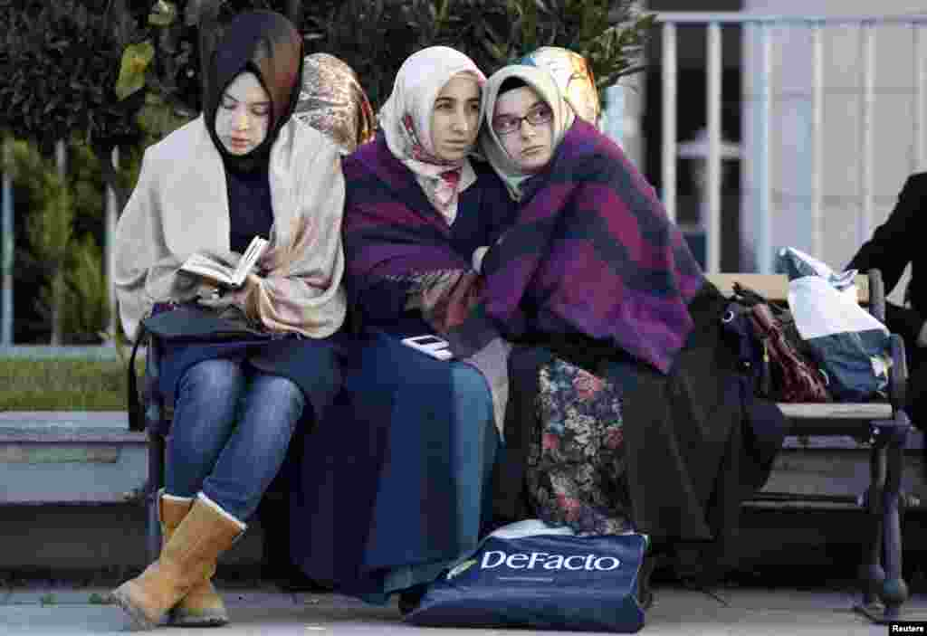 Relatives and supporters of people who were detained by police wait outside the Justice Palace in Istanbul, Turkey, Dec. 14, 2014.