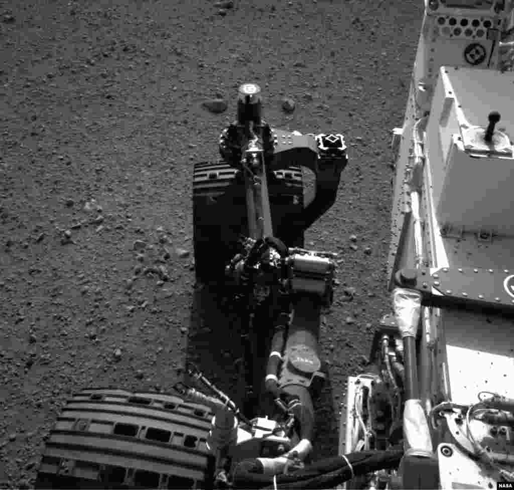 Engineers wiggled the wheels as a test of the rover's steering and anticipate embarking on Curiosity's first drive in the next couple of days.