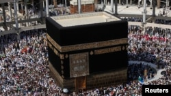 FILE - Muslim pilgrims circle the Kaaba at the Grand mosque during the annual Haj pilgrimage, in the holy city of Mecca, Oct. 17, 2013.
