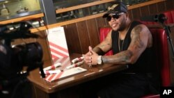 "Flo Rida shot his ""Hello Friday"" music video at TGI Fridays in Los Angeles, March 16, 2016."