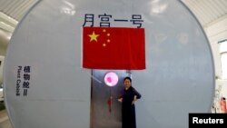 Liu Hong, chief designer of the Lunar Palace 365 Project stands outside a simulated space cabin in which volunteers temporarily live as a part of the project at Beihang University in Beijing, China, July 9, 2017.
