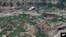 سیلابی ریلے میں بہنے والوں کی تلاش میں ہیلی کاپٹروں سے بھی مدد لی گئی