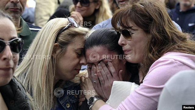A protester cries during an anti-bailout rally by employees of Cyprus Popular Bank, outside parliament, Nicosia, March 22, 2013.