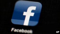 FILE - The Facebook logo is displayed on an iPad in a May 16, 2012, illustration photo.