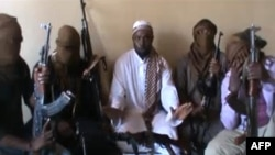 File - Boko Haram leader Abubakar Shekau, center, flanked by militants in April 2012 screengrab image (AFP Photo/YouTube).