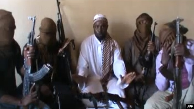 Boko Haram's second-in-command, Abubakar Shekau, flanked by militants in screengrab of April 2012 video shot in unknown location.
