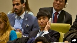 North Korean dissident Shin Dong-Hyuk holds his earpiece as he listens during a meeting of the U.N. General Assembly human rights committee on a proposal to refer North Korea to the International Criminal Court for alleged crimes against humanity, Nov. 18
