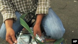 A vendor sells pirated DVDs in Vietnam