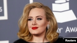 FILE - British singer Adele arrives at the 54th annual Grammy Awards in Los Angeles, Feb. 12, 2012.