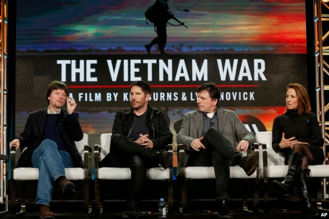 "FILE - Ken Burns, from left, Trent Reznor, Atticus Ross and Lynn Novick speak at PBS' ""The Vietnam War"" panel at the 2017 Television Critics Association press tour in Pasadena, Calif."