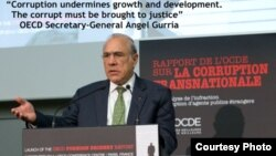 OECD Secretary-General Angel Gurria at a press conference to discuss the Foreign Bribery Report.