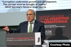 FILE - OECD Secretary-General Angel Gurria.