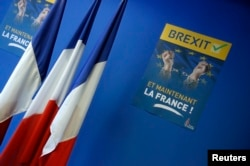 "A poster reading ""Brexit, And now France"" is seen near French flags before a news conference at the France's far-right National Front political party headquarters in Nanterre near Paris."